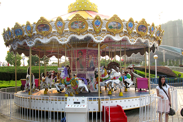 Dinis child coin operated carousel ride