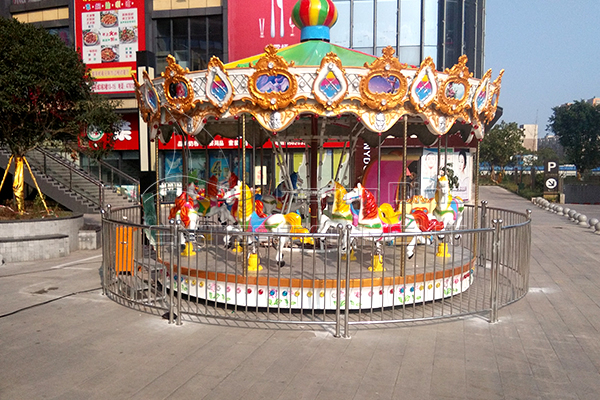 Dinis small coin operate carousel