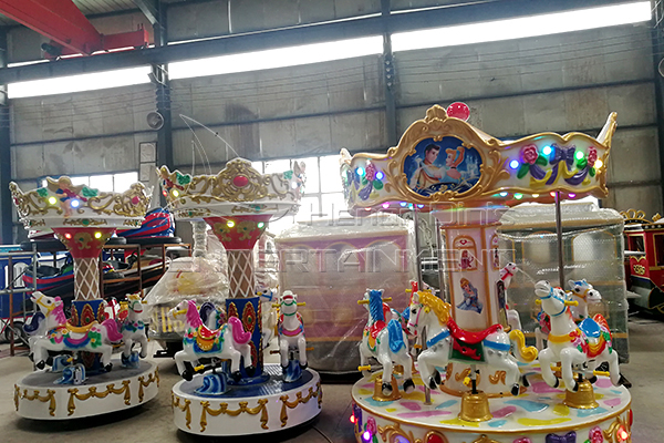coin operated 3 horse carousel is available in Dinis