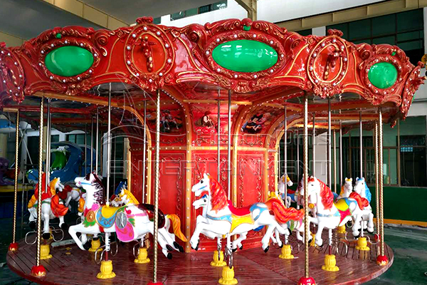 Old fashioned carousel rotating horses for sale